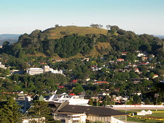 Mount Eden - Mount Eden looming high above suburban Epsom viewed from Maungakiekie / One Tree Hill