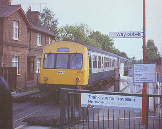Network SouthEast - Transitional scene from BR Blue (the train) to NSE (the signage, train sticker) at Farnborough North station