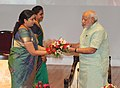 "Narendra Modi being presented a bouquet by the Union Minister for Human Resource Development, Smt. Smriti Irani, at the ""Teachers' Day"" function, at Manekshaw Auditorium, in New Delhi on September 05, 2014.jpg"