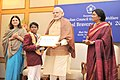 Narendra Modi presenting the National Bravery Awards 2015 to the children, in New Delhi on January 24, 2016. The Union Minister for Women and Child Development, Smt. Maneka Sanjay Gandhi is also seen (5).jpg