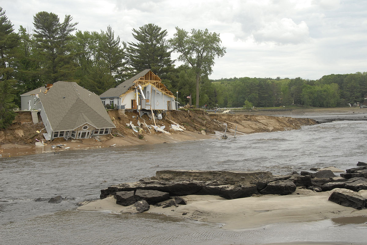 New Dell Creek Channel draining Lake Delton with wrecked homes.jpg