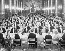 Black-and-white photo of large banquet