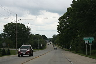 Oconto Falls, Wisconsin - Looking southeast at the welcome sign for Oconto Falls