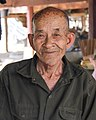 Old Lao man with big chin and wrinkles (cropped).jpg