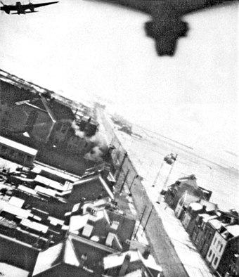 NZ Mosquitoes over Amiens during Operation Jericho, the jailbreak raid. Operation Jericho - Amiens Jail During Raid 1.jpg