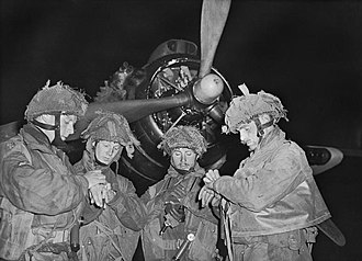 Denison smock - 5/6 June 1944. Pathfinder officers synchronising their watches in front of an Armstrong Whitworth Albemarle before flying into battle in Normandy. They all wear 2nd Pattern Denison smocks