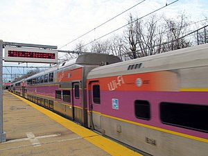 MBTA Commuter Rail - Two coaches in 2012 with wraps indicating that they are wi-fi enabled. This 2008-built system will be replaced with a new system.