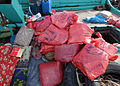 Over 50 bags of hashish are piled on the deck of Decatur (DDG 73) on December 16, 2003.jpg