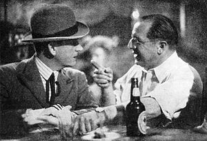 The Threepenny Opera (1931 film) - Film director Georg Wilhelm Pabst (right) and actor Albert Préjean (as Mackie Messer) during the filming of L'Opéra de quat'sous (The Threepenny Opera) in 1931