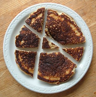 Lazy caterer's sequence - Pancake cut into seven pieces with three straight cuts.