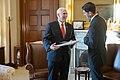 Paul Ryan giving Mike Pence a Christmas gift.jpg