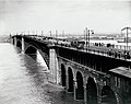 Pedestrian and trolley traffic on Eads Bridge during 1903 flood.jpg