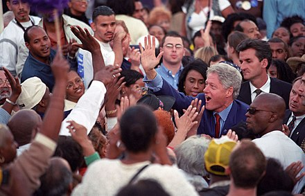 "Clinton at a Democratic ""Get out the vote"" rally in Los Angeles, California, on November 2, 2000 Photograph of President William Jefferson Clinton Greeting People in a Large Crowd at a ""Get Out the Vote"" Rally in Los Angeles, California, 11 02 2000.jpg"