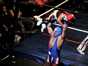 Mini-Estrella - Pierrothito lifting Tzuki during a match in the United States.