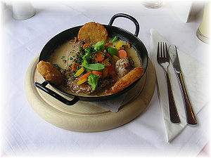 Pork - A traditional Austrian pork dish, served with potato croquettes, vegetables, mushrooms and gravy.