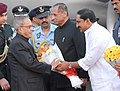 Pranab Mukherjee being welcomed by the Governor of Andhra Pradesh, Shri E.S.L. Narasimhan and the Chief Minister of Andhra Pradesh, Shri N. Kiran Kumar Reddy, on his arrival, at Hakimpet airbase, in Hyderabad.jpg