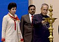 Pranab Mukherjee lighting the lamp at the presentation ceremony of the National Awards for the Empowerment of Persons with Disabilities 2013, in New Delhi. The Union Minister for Social Justice & Empowerment.jpg