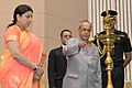 Pranab Mukherjee lighting the lamp on the occasion of the International Literacy Day celebrations, in New Delhi on September 08, 2015. The Union Minister for Human Resource Development, Smt. Smriti Irani is also seen.jpg