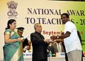 Pranab Mukherjee presenting the National Award for Teachers-2013 to Shri Sivaprasad G, Kerala, on the occasion of the 'Teachers Day', in New Delhi. The Union Minister for Human Resource Development.jpg