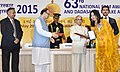 Pranab Mukherjee presenting the Rajat Kamal Award to the Producer Auto Driver, Rep Ms. Longjam Meena Devi for Best Film on Social Issues, in Non-Feature Film Section, at the 63rd National Film Awards Function, in New Delhi.jpg