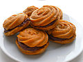 Pumpkin whoopie pies with chocolate filling (8011444838).jpg