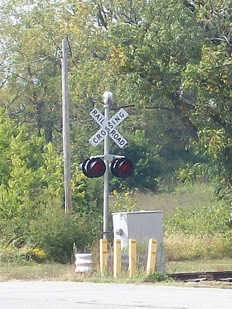 Grade crossing signals - Railroad crossing signal in Belton, MO, USA, with bell and warning lights, as seen in September 2007