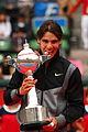 Rafael Nadal mordiendo la copa - 0027 Japan Open Tennis Tokio 2010.jpg