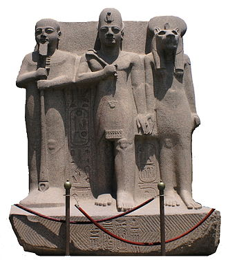 Memphis, Egypt - Rameses II flanked by Ptah and Sekhmet.