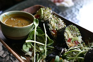 Raw vegan lunch. Spicy seaweed wraps with pean...