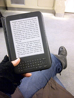 Amazon company wikivisually e reader using a kindle keyboard e reader on public transit fandeluxe Images