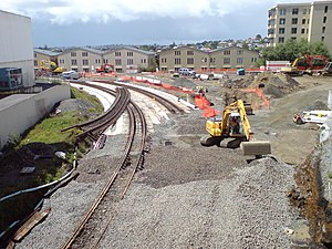 Auckland railway electrification - Rail works preceding electrification, such as the triangle north of Newmarket, incorporated provision for electrification, such as base foundations. Bridge works increased clearances for the catenary.