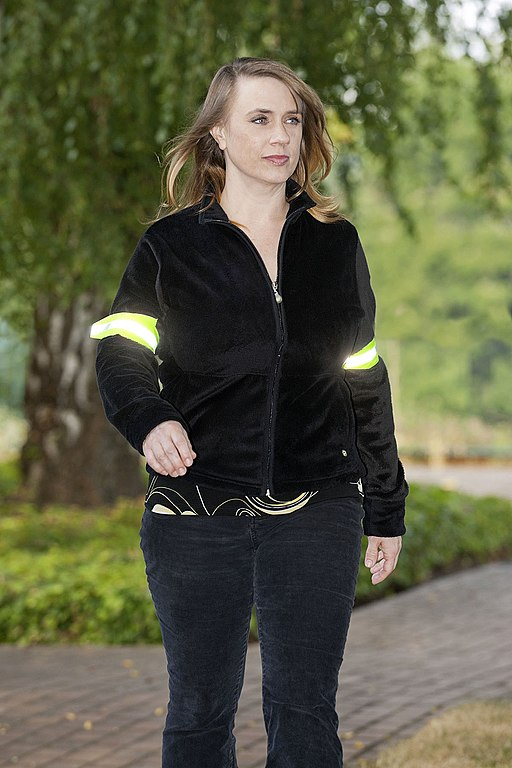Woman walking with reflective bands arm bands