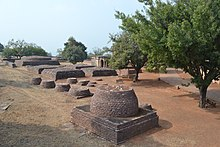 Remains of smaller stupas at Sanchi.jpg