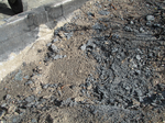 Remains of torched trash containers (closeup).png