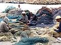 Repairing nets in the port at Djerba-sparklenose.jpg