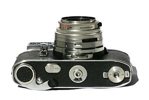 Kodak Retina Reflex - Bottom of the Retina Reflex III with the winding lever, the frame counter, the counter advance button and the back opening