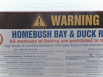 Homebush Bay - Multilingual sign warning against fishing in the bay.