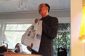 Rosenberg Fund for Children - Robert Meeropol (2009) holding a copy of the RFC newsletter.