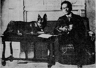 "Royal Dixon - Royal Dixon in 1921 with a police dog ""monitoring"" his preaching. According to him dogs took to the Ten Commandments faster than other animals."