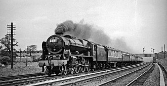 LMS Royal Scot Class - Rebuilt 'Royal Scot' 7P 4-6-0 No. 46122 'Royal Ulster Rifleman' on the West Coast Main Line in 1957