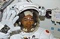 S114E6027 - STS-114 - Noguchi in airlock - DPLA - e8258c0ca3685fe5de8da0c39875ef04.jpg