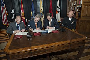 Christopher L. Eisgruber -  PRINCETON, N.J. (April 15, 2014) Secretary of the Navy (SECNAV) Ray Mabus, second from left, President of Rutgers University Robert Barchi, left, and President of Princeton University Christopher Eisgruber sign an agreement bringing Navy ROTC back to Princeton University, as Capt. Philip Roos, commanding officer of Rutgers Navy ROTC looks on. (U.S. Navy photo by Mass Communication Specialist 1st Class Arif Patani/Released)