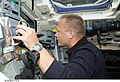 STS-127 Hurley works controls.jpg