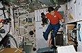 STS-41 Pilot Cabana holds 16mm camera on OV-103's middeck.jpg