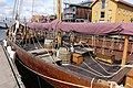 Saga Farmann Klåstadskipet viking ship replica built 2018 mast yard sail shroud barrels chests Tønsberg harbour havn brygge pier board walk dock brygga Tønsbergs Blad Kaldnes bro footbridge wooden buildings etc Norway 2019-08-16 04.jpg
