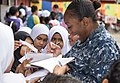 Sailor interacts with students during a community engagement event in Lumut, Malaysia. (37225963891).jpg