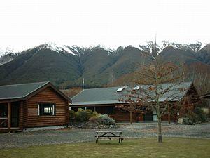 Saint Arnaud, New Zealand - Youth hostel cottages, the Saint Arnaud Range behind.