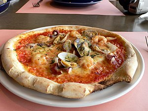 Seafood pizza - A seafood pizza with clams, shrimp and octopus.