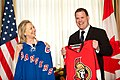 Secretary Clinton and Canadian Foreign Minister Baird Place a Friendly Hockey Bet (6928253510).jpg