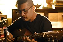 Shashwat on guitar.jpg